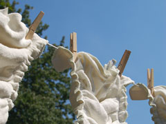 clean diapers hanging on a clothesline